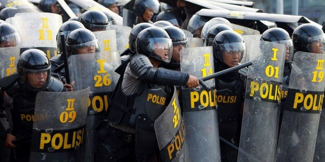 Indonesian police during a protest in Medan on March 26, 2012. Around 200 prisoners escaped from an Indonesian jail Thursday after violent riots erupted, with inmates setting fire to the prison and hurling bottles at guards.