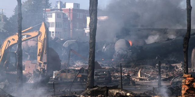 This photo provided July 8, 2013 by Surete du Quebec, shows wrecked oil tankers and debris from a runaway train that derailed and exploded in Lac-Megantic, Quebec, Canada.