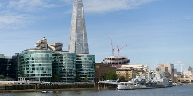 """The """"Shard"""" tower pictured on the south bank of the river Thames in central London on July 22, 2012. Rupert Murdoch's News Corporation on Friday announced plans to move all of its London operations into a new building in the shadow of Western Europe's tallest skyscraper."""