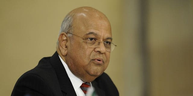 South African Finance Minister Pravin Gordhan speaks during a joint press conference with World Bank newly-appointed President on September 6, 2012 in Pretoria. South Africa's top tax official has resigned following an investigation into allegations of impropriety, Gordhan announced Friday.