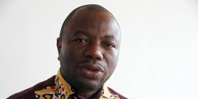 Damana Adia Pickass, a top ally of ex-Ivory Coast president Laurent Gbagbo, gives an interview on July 15, 2013 in Accra. Pickass on Monday accused the country's new leader of being dishonest in his efforts to heal divides two years after a brutal civil conflict.