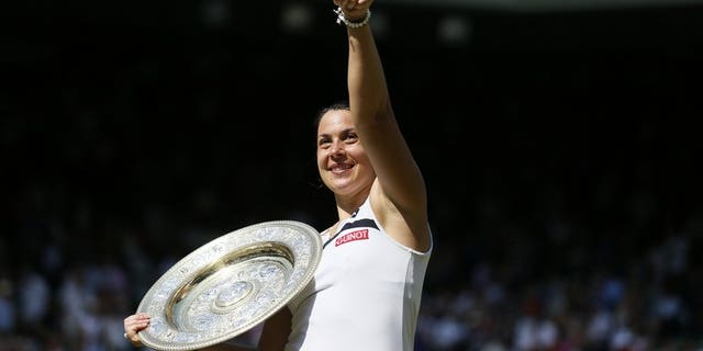 France's Marion Bartoli after winning Wimbledon on July 6, 2013. Bartoli will team up with the popular Jo-Wilfried Tsonga for France to open their 2014 season at the Hopman Cup in Perth.