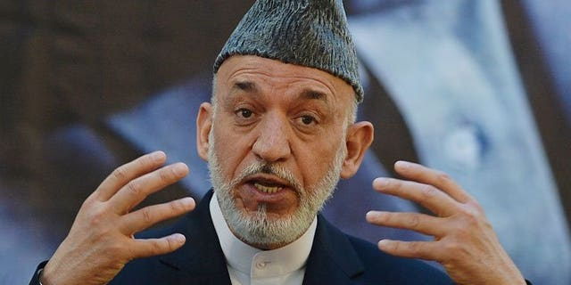 Afghan President Hamid Karzai speaks during a joint press conference with NATO Secretary General Anders Fogh Rasmussen at a military academy outside Kabul on June 18, 2013. Karzai on Wednesday approved changes to the make-up of Afghanistan's electoral complaints watchdog, removing foreign UN representatives before presidential polls next year.