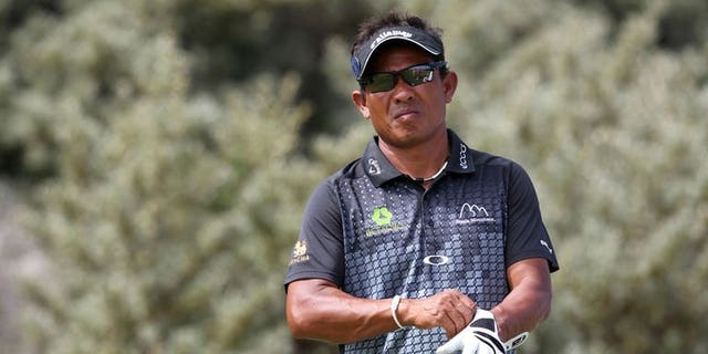 Thailand's Thongchai Jaidee prepares to play the eighth tee during the first round of the 2013 British Open Golf Championship at Muirfield golf course at Gullane in Scotland on July 18, 2013. Thongchai bowed out from the British Open on Friday despite battling to a second round even-par 71.