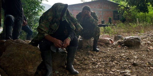 """FARC guerrillas in the rural area of Caloto, Colombia, on June 4, 2013. The leftist rebels said they captured a US soldier last month and are offering his release as a """"gesture"""" toward peace with Bogota."""