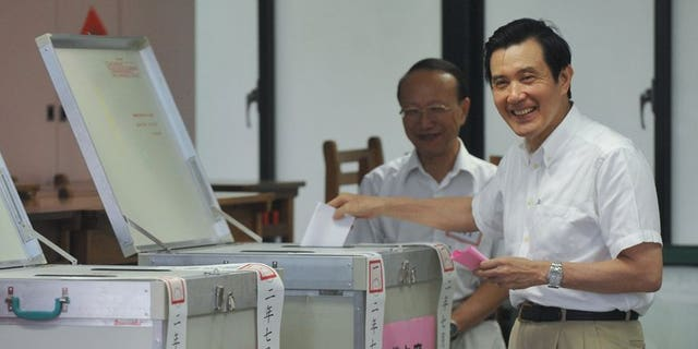 Taiwan President Ma Ying-jeou casts his ballot during an election for the ruling Kuomintang party in Taipei, on July 20, 2013. Ma has been overwhelmingly reelected chairman of the ruling party, amid corruption scandals involving top officials and public anger at his government.