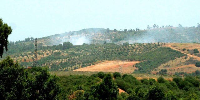 An Algerian army helicopter flies over a zone where troops gfought Islamists in Kabyle zone, east of Algiers August 29, 2007.