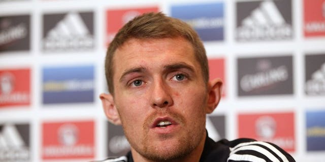 Darren Fletcher speaks during a press conference in Brussels on October 15, 2012. Manchester United midfielder Fletcher admitted on Sunday that he will miss the start of his side's Premier League title defence as he continues to recover from a bowel operation.