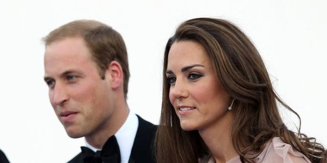 Britain's Duke and Duchess of Cambridge, Prince William (L) and Catherine, arrive for a charity gala dinner, at Kensington Palace in London on June 9, 2011.