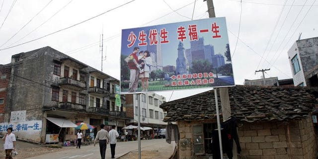 """A Chinese """"one-child"""" policy billboard saying, """"Have less children, have a better life"""" greets residents in Shuangwang, Guangxi region, on May 25, 2007. A knife-wielding man has stormed an office enforcing China's one-child policy, stabbing two officials to death and injuring four people after a row over his offspring."""