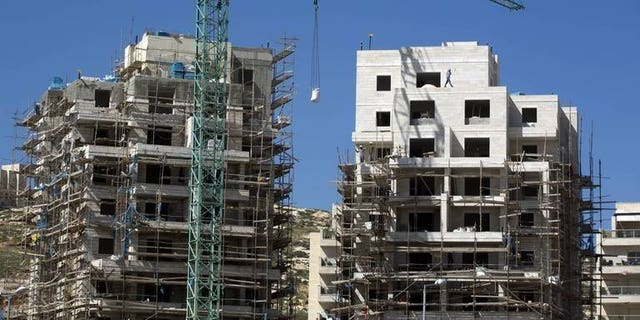 A housing construction site in the Israeli settlement of Har Homa in east Jerusalem, is pictured on February 27, 2013. EU foreign policy chief Catherine Ashton is pushing for comprehensive guidelines to introduce separate labelling for products from Israeli settlements in the West Bank, a newspaper reported on Tuesday.
