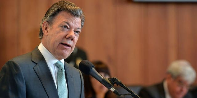 """Handout picture released by the Colombian Presidency showing Colombia's President Juan Manuel Santos delivering a speech at the Constitutional Court in Bogota, Colombia, on July 25, 2013. Colombia admitted for the first time Thursday that the government has been guilty of """"serious human rights violations"""" during its 50-year battle with leftist rebels."""