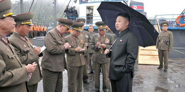 This undated picture released by North Korea's official Korean Central News Agency (KCNA) on May 28, 2013 shows North Korean leader Kim Jong-Un (R, front) inspecting the August 25 Fishery Station under the Korean People's Army (KPA) Unit 313. Kim has held talks with China's Vice President Li Yuanchao during commemorations of the anniversary of the Korean War ceasefire, state media said Friday.