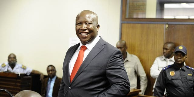 South African populist firebrand Julius Malema smiles as he arrives in court on September 26, 2012 in Polokwane. Malema launched South Africa's newest political party Saturday to take on his former party, the ruling African National Congress (ANC), in polls next year.