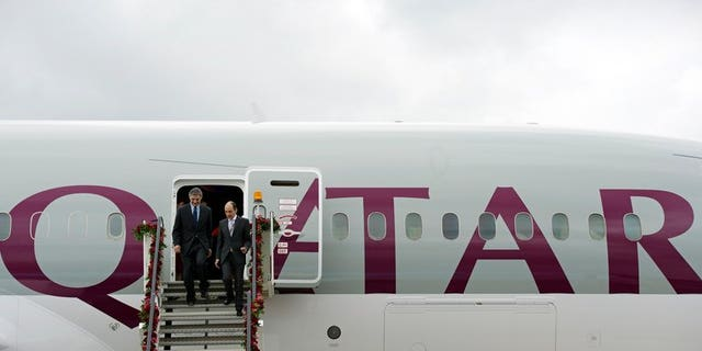 """Boeing CEO Ray Conner (left) and Qatar Airways CEO Akbar Al Baker on a Dreamliner at Farnborough in July 2012. A Qatar Airways Boeing 787 Dreamliner resumed flights on Wednesday after being grounded for several days because """"technical components required replacement,"""" the company said."""
