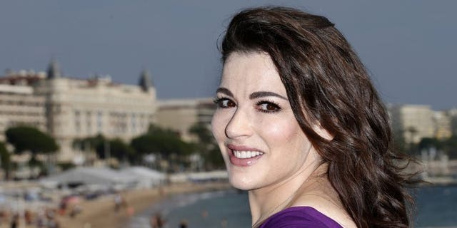 """British TV chef Nigella Lawson pictured during a photocall for the television show """"Nigellissima"""" in Cannes, southeast France, on October 9, 2012. Lawson and multi-millionaire art collector Charles Saatchi moved closer to ending their decade-long marriage on Wednesday after pictures emerged showing him grabbing her neck."""