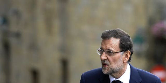 Lawmakers on Thursday will grill Spain's Prime Minister Mariano Rajoy, pictured July 29,2013, over a corruption scandal that has sparked calls for him to quit.