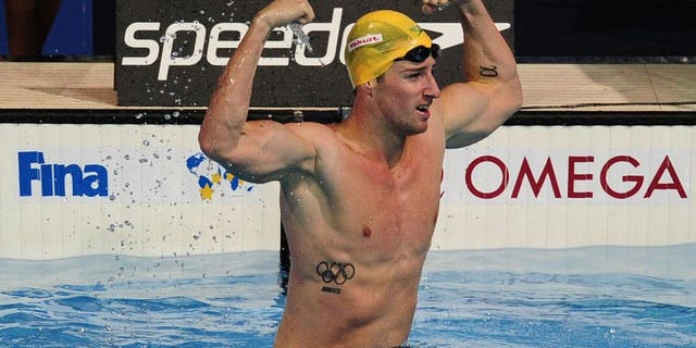 Australia's James Magnussen celebrates after winning the final of the men's 100-metre freestyle swimming event in the FINA World Championships at Palau Sant Jordi in Barcelona on August 1, 2013.