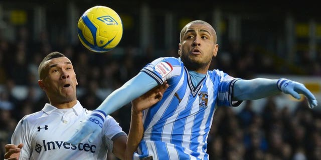 Coventry City's Leon Clarke (right) outjumps Tottenham's Steven Caulker in an FA Cup game at White Hart Lane on January 5. Coventry City said on Friday they were on the verge of liquidation, which will trigger a 15-point deduction just 24 hours before their 2013-2014 League One season begins.