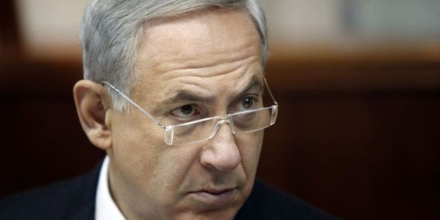 Israeli Prime Minister Benjamin Netanyahu opens the weekly cabinet meeting in Jerusalem, on August 4, 2013. Netanyahu has lashed out at new Iranian President Hassan Rowhani, saying that he shared his hardline predecessor's aim of destroying the Jewish state.