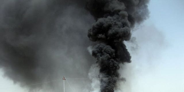 A file picture taken on June 12, 2012 shows black smoke billowing into the sky after Yemeni tribesmen destroyed an oil pipeline in the eastern province of Marib. Tribesmen have blown up the main export pipeline linking eastern oilfields to the Red Sea coast, halting the flow of oil.
