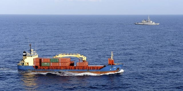 A cargo ship carrying sensitive cargo is escorted by a French military frigate in the Gulf of Aden on January 11, 2009. Britain has issued the highest possible security alert to British shipping companies operating off the coast of Yemen, an expert said on Tuesday, amid a worldwide terror alert focused on the country.