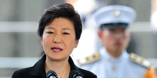 """South Korean President Park Geun-Hye speaks in Busan on July 22, 2013. Park condemned what she termed an attempt """"to erase history"""" as she weighed in Tuesday on a murky case involving a missing inter-Korean summit transcript."""
