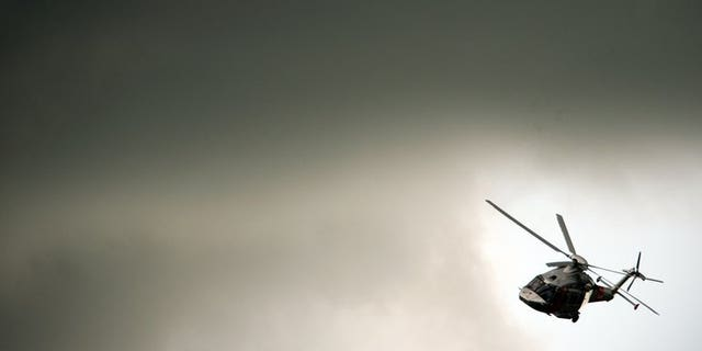 An AgustaWestland helicopter flies through the clouds at the Farnborough International Airshow in Hampshire, southern England, on July 11, 2012. Indian auditors accused the government Tuesday of breaking its own procurement rules to award a $748-million helicopter contract to Italian-owned AgustaWestland, which is under investigation for bribery, the Press Trust of India reported.