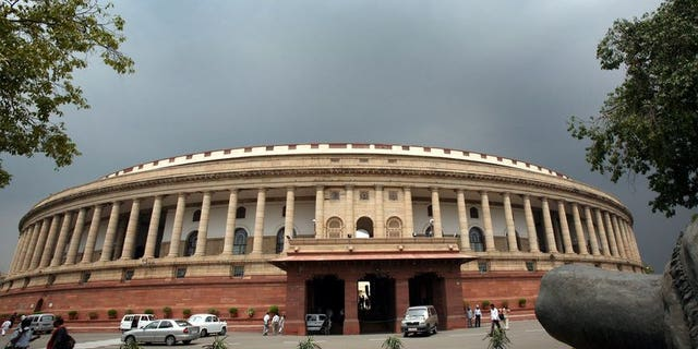 """Indian lawmakers arrive at Parliament House in New Delhi, on July 25, 2006. A furious speaker of India's upper house of parliament has accused lawmakers of behaving like a """"federation of anarchists"""" after more unruly behaviour which has paralysed decision-making in recent years."""