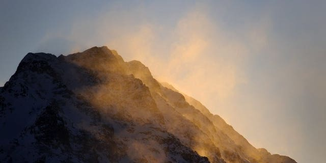 The sun rises over Swiss Alps on December 12, 2010 in St. Moritz. A British man flying in a wingsuit was killed Wednesday after plunging into a mountain ridge in the Swiss Alps, police said.