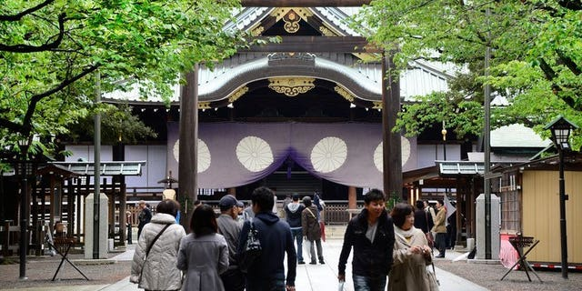 People visit Yasukuni Shrine in Tokyo on April 21, 2013. Dozens of Japanese politicians are expected to visit a controversial war shrine Thursday, in a move sure to anger China and South Korea which see it as a potent symbol of Tokyo's imperialist past.