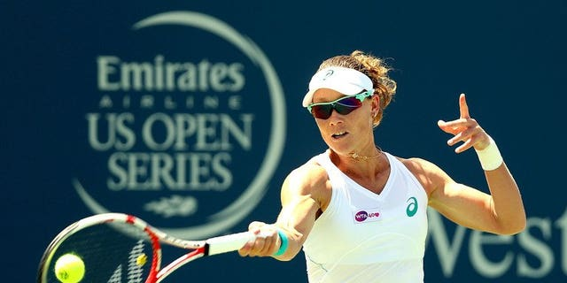 Samantha Stosur of Australia returns a shot to Jamie Hampton on August 14, 2013. The former US Open champion on Saturday said she had split with long-time coach David Taylor.