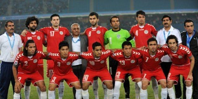 Afghanistan national football team players pose for a group photograph during the Saff championship 2011 final football tournament at Jawahar Lal Nehru Stadium (JNS) in New Delhi on December 11, 2011. Pakistan football authorities on Saturday said they were delighted at the prospect of playing their first match in Afghanistan for 36 years.
