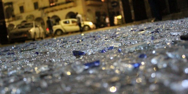 Pieces of glass litter the street in Benghazi on July 28, 2013 after two powerful explosions. A bomb exploded Saturday in front of Egypt's consulate in the eastern Libyan city of Benghazi, causing some damage to the building but no casualties, a security official said.