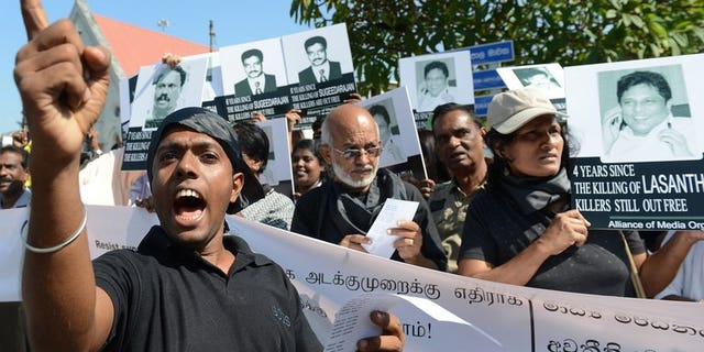 Sri Lankan journalists and media activists demonstrate, demanding investigations into over a dozen killings of editors, reporters and newspaper workers in recent years, in the capital Colombo on January 29, 2013. A Sri Lankan media rights group on Sunday accused the military of intimidating journalists who reported a deadly army crackdown on villagers protesting at contaminated water supplies.