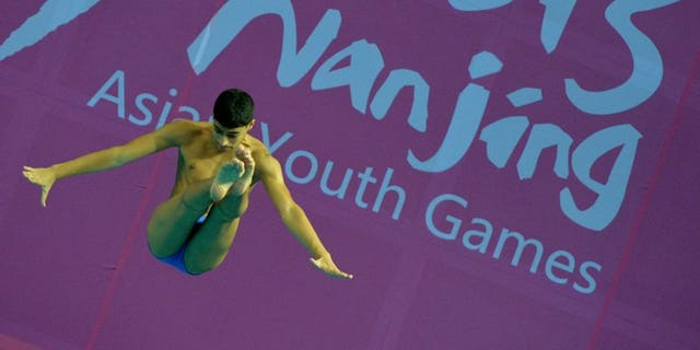 Hasan Qali of Kuwait competes in the 3m springboard at the Asian Youth Games in Nanjing on August 17. India's bungling sports officials were left red-faced on Monday after 17 track and field athletes were thrown out of the ongoing Asian Youth Games in Nanjing, China for being over-aged.