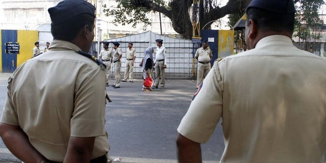 File picture shows police outside the high-security Yerwada Jail in Pune, western India, on November 21, 2012. A leading Indian rationalist, who was campaigning for a law to eradicate superstition in a country famed for its mystics and gurus, was shot dead in Pune on Tuesday, police said.