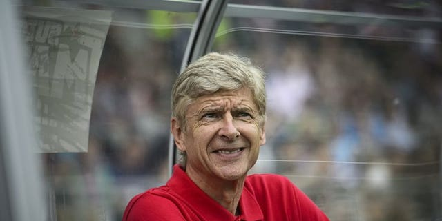Arsenal's Manager Arsene Wenger follows the pre-season match between Premier League giants Manchester City and Arsenal in Helsinki on August 10, 2013. Wenger received some welcome news when five players feared to have contracted injuries at the weekend reported for training.
