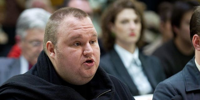 Megaupload founder Kim Dotcom speaks at Bowen House in Wellington on July 3, 2013 as lawmakers examine a controversial proposal allowing intelligence agencies to spy on local residents. New Zealand passed legislation Wednesday allowing its main intelligence agency to spy on residents and citizens, despite opposition from rights groups, international technology giants and the legal fraternity.