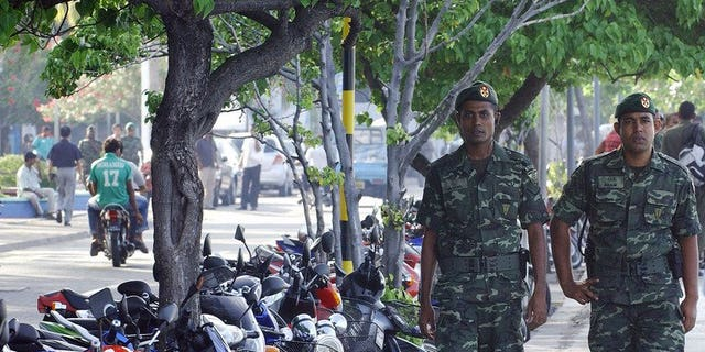 File photo of Maldivian security personel on patrol in Male. The Maldivian High Court has overturned a public flogging sentence for a 15-year-old rape victim whose conviction sparked outrage among rights groups and focused attention on the island nation treatment of women.