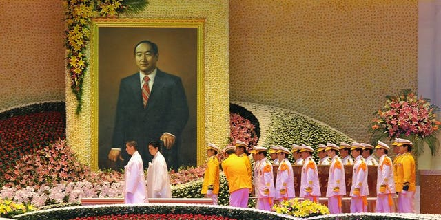 Unification Church honour guards carry the coffin of founder Sun Myung Moon during his funeral ceremony at the Cheongshim Peace World Center in Gapyeong, about 60 km east of Seoul, on September 15, 2012.