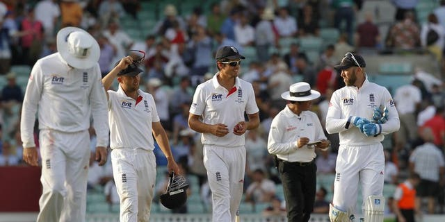 Alastair Cook (centre) and England team-mates leave the pitch at The Oval at stumps on Wednesday. Rain delayed the scheduled 11.00am local time (1000GMT) start of the second day's play in the fifth and final Ashes Test between England and Australia at The Oval on Thursday.