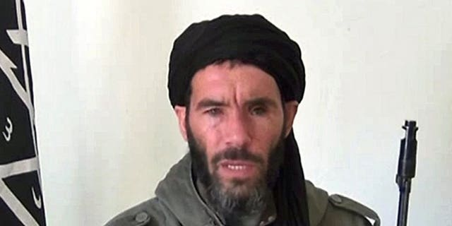An undated grab from a video obtained by ANI Mauritanian news agency shows former commander of Al-Qaeda in the Islamic Maghreb (AQIM) Mokhtar Belmokhtar speaking at an undisclosed location. An Al Qaeda-linked militia founded by wanted Islamist commander Belmokhtar announced Thursday it had joined forces with another armed group to take revenge against France for its military offensive in Mali.