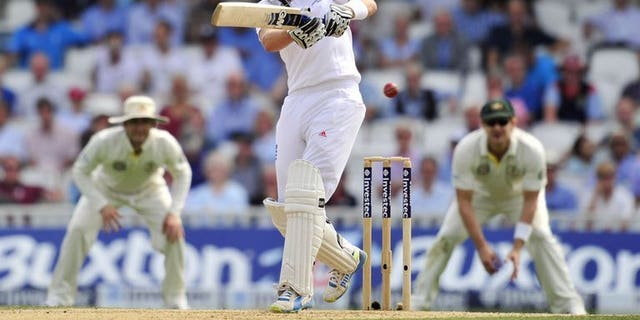 England's Joe Root plays a pull shot to reach his half century on the third day of the fifth Ashes Test agaisnt Australia at The Oval in south London on August 23, 2013. Root scored only his second fifty of this Ashes after Australia captured the prize wicket of England captain Alastair Cook on Friday.