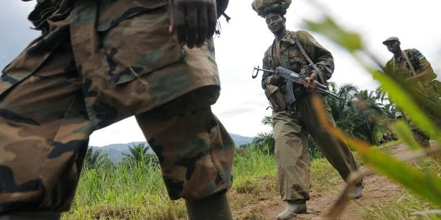 """Rwandan Defence Force soliders on February 05, 2009 in Pinga, 150kms north west of Goma. Rwanda's army has warned neighbouring Democratic Republic of Congo, who it accuses of deliberate bombing over the border, that it will not stand by """"indefinitely"""", in a statement late Friday."""