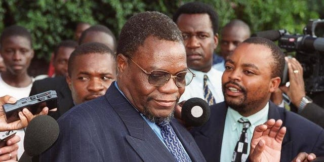 Zimbabwe's then Minister of Land and Agriculture Kumbirai Kangai leaves Harare Magistrates Court March 21, 2000. Kangai, a close ally of President Robert Mugabe and key leader in the fight to end British rule, died Saturday, a party official said.