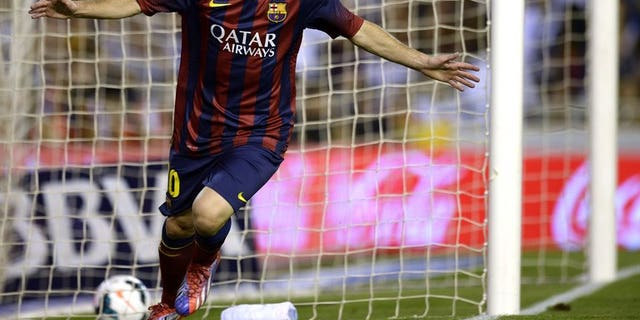 Barcelona's Argentinian forward Lionel Messi celebrates after scoring a goal against Valencia at the Mestalla stadium in Valencia on September 1, 2013. Messi and his father have repaid five million euros ($6.6 million) owed to the taxman before facing court on tax evasion charges, according to a judge's ruling.