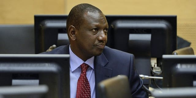 Kenyan vice-president William Samoei Ruto attends a trial hearing in the International Criminal Court in the Hague, Netherlands, on May 14, 2013. Ruto has left Nairobi to fly to The Hague, a day before the start of his crimes against humanity trial.