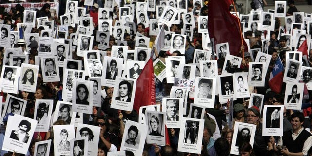 Chilean human rights activists take part in a demonstration in Santiago on September 8, 2013. A thousand people lay on the ground Tuesday in Chile's capital in memory of those still missing from the dictatorship of Gen. Augusto Pinochet.