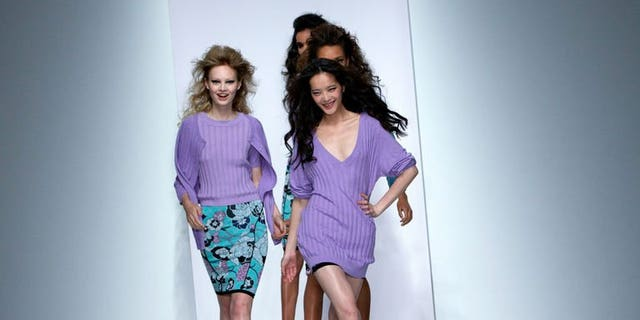Models present creations by Sister By Sibling during the 2014 Spring/Summer London Fashion Week in London on September 14, 2013.